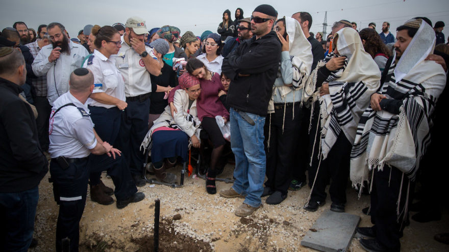 Friends and family attend the funeral of terror victim Rabbi Raziel Shevah, 35, in the Samaria settlement outpost of Havat Gilad on Jan. 10, 2018. Credit: Miriam Alster/Flash90.