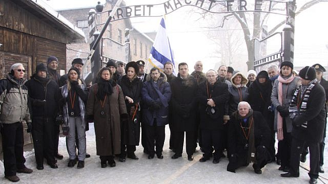 Israel Parliament members pose for a group picture at the entrance to the Auschwitz concentration camp in Poland on International Holocaust Remembrance Day, Jan. 27, 2010. Photo by Isaac Harari/Flash90.
