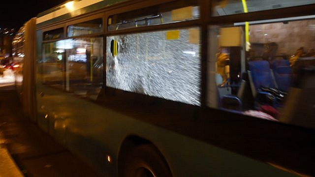 File photo: View of a broken window after Palestinians youths threw stones at an Israeli bus on October 14, 2013. Photo by Sliman Khader/FLASH90