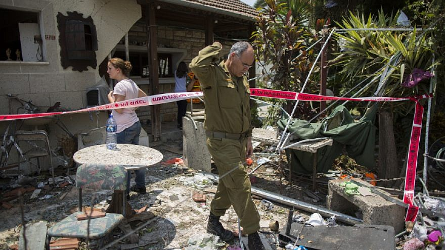File Photo: Israeli home struck by a rocket fired from the Gaza Strip on the Israeli town of Yehud, on July 22, 2014, during Operation Protective Edge. Photo by Yonatan Sindel/Flash90