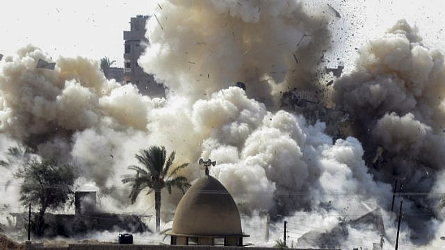 File photo: Smoke rises after a house was blown up during a military operation by Egyptian security forces in the Egyptian city of Rafah near the border with southern Gaza Strip, on October 29, 2014. Photo by Abed Rahim Khatib/Flash90