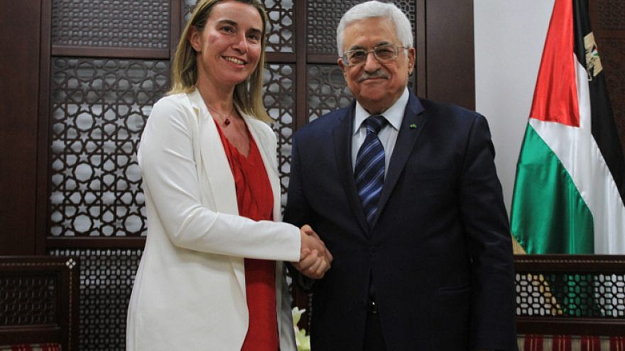 File photo: Palestinian National Authority President Mahmoud Abbas meets the European Union foreign policy chief Federica Mogherini in Ramallah on November 8, 2014. Photo by STR/Flash90