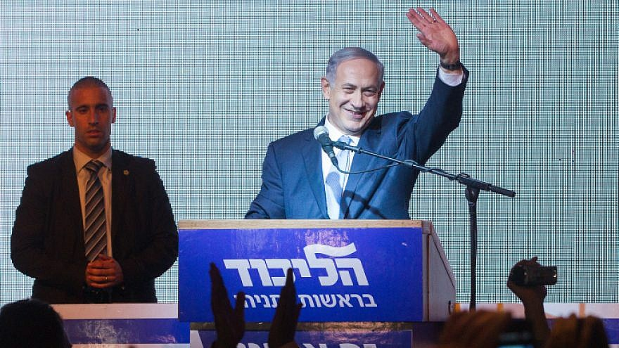Israeli Prime Minister Benjamin Netanyahu waves to supporters at Likud headquarters in Tel Aviv on March 18, 2015, after general elections with Netanyahu claiming victory. Photo by Miriam Alster/Flash90.