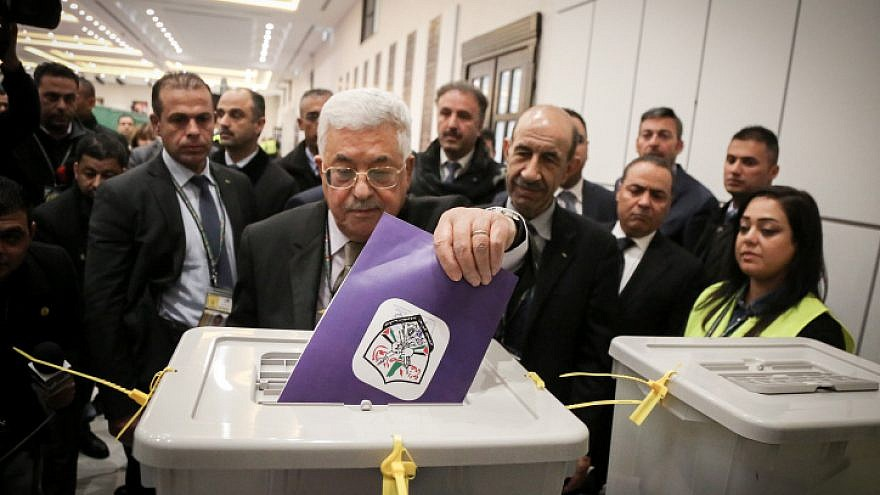 Palestinian Authority leader Mahmoud Abbas casts a vote for members of the Fatah Party's ruling bodies at the Muqataa, P.A. headquarters in the West Bank city of Ramallah on Dec. 3, 2016. Photo by Flash90.