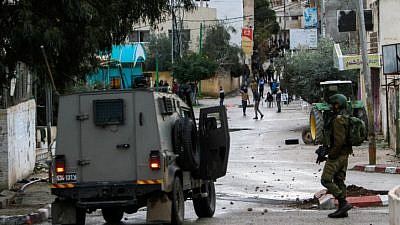 Palestinians clash with Israeli soldiers in the West Bank city of Jenin, January 18, 2018. Photo by Nasser Ishtayeh/Flash90.