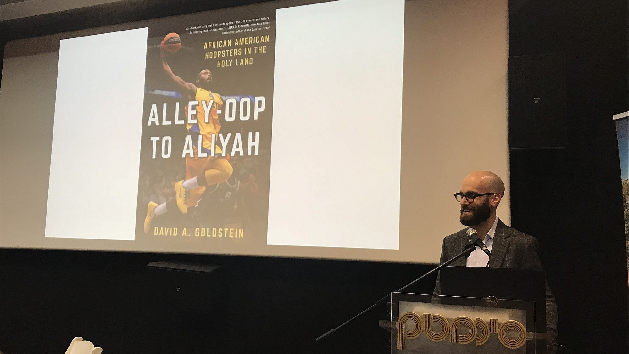 Author David Goldstein speaks about his book at a Nefesh B'Nefesh event in Jerusalem. Credit: Eliana Rudee.