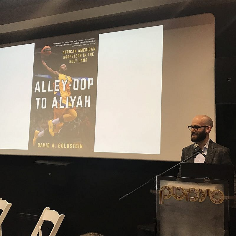 Author David Goldstein speaks about his book at a Nefesh B'Nefesh event in Jerusalem. Credit: Eliana Rudee