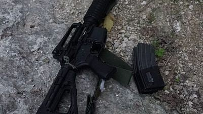 Weapons belonging to Ahmed Nassar Jarrar, the head of the Palestinian terror cell that on Jan. 9 murdered Israeli father of six and volunteer medic Rabbi Raziel Shevach. Credit: IDF via Twitter.