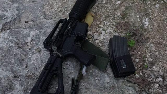 Weapons belonging to Ahmed Nassar Jarrar, the head of the Palestinian terror cell that on Jan. 9 murdered Israeli father of six and volunteer medic Rabbi Raziel Shevach. Credit: IDF via Twitter.