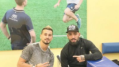 Maor Buzaglo, left, and Iran's Ashkan Dejagah in a photo posted on Buzaglo's Facebook page on March 18, 2018. Credit: Facebook.