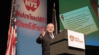 Allen Fagin, executive vice president of the Orthodox Union, addresses the crowd of students, parents and school officials in Albany, N.Y., to advocate for more private-school educational funding. Credit: Semeraro Photography.
