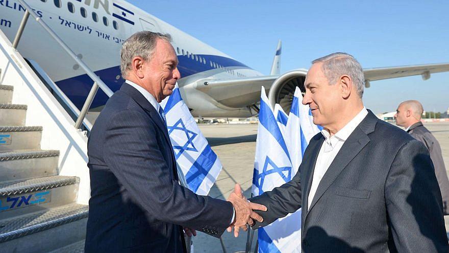 Israeli Prime Minister Benjamin Netanyahu greets former New York City Mayor Michael Bloomberg (left) as he arrives in Israel in July 2014. Photo by Haim Zach/GPO/Flash 90