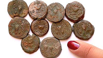 Some of the bronze coins found near the Temple Mount in Jerusalem. Eilat Mazar, Hebrew University of Jerusalem.