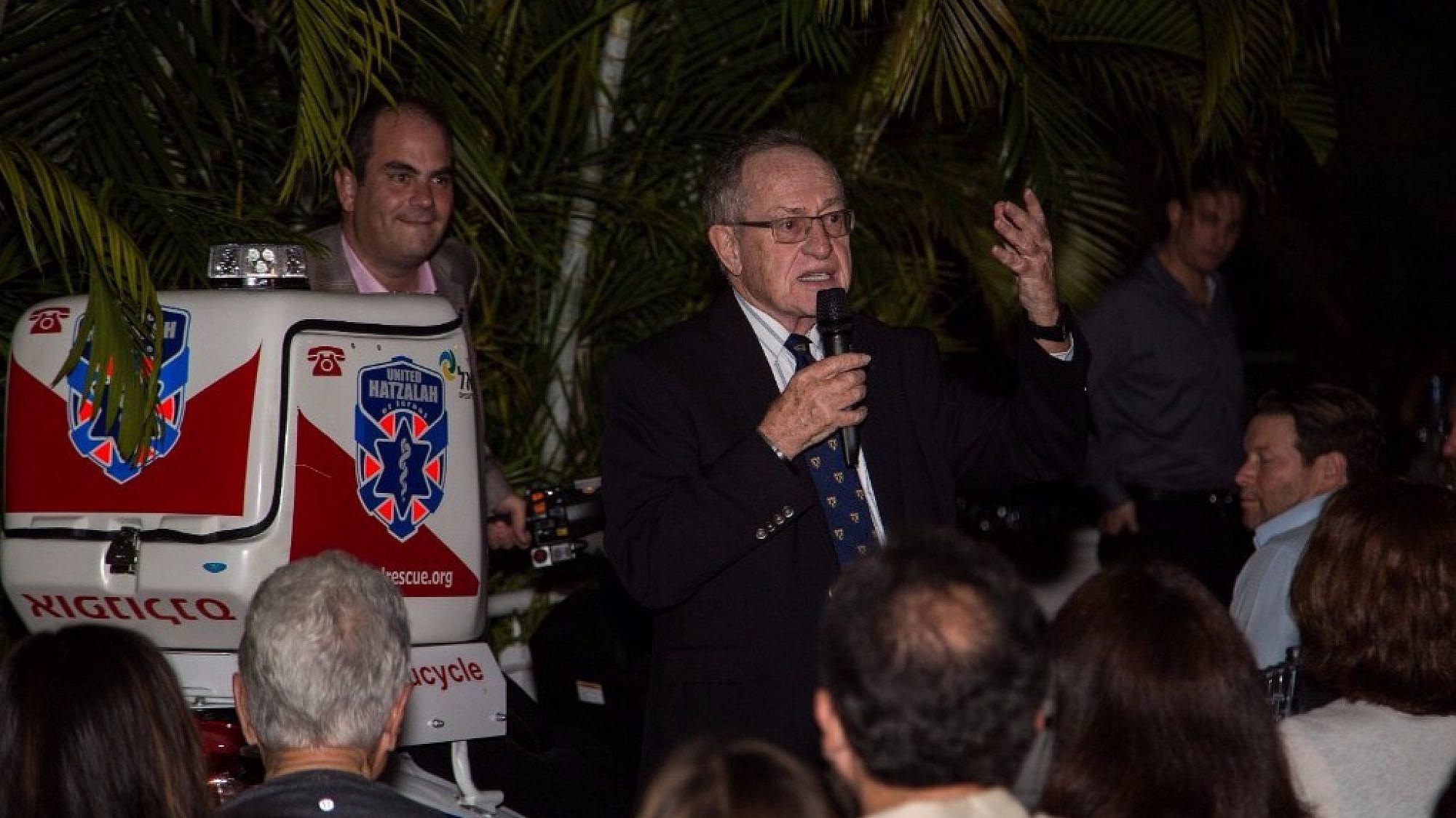 Alan Dershowitz speaking at a ceremony highlighting his donation of a ambucycle to Israel's volunteer medic organization, United Hatzalah. Credit: United Hatzalah.