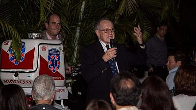 Alan Dershowitz speaking at a ceremony highlighting his donation of a ambucycle to Israel's volunteer medic organization, United Hatzalah. Credit: United Hatzalah.