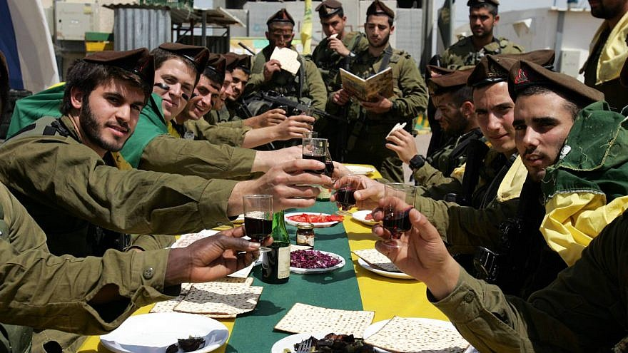 Israeli soldiers of the Golani brigade eat a Passover meal. Credit: Edi Israel/Flash90