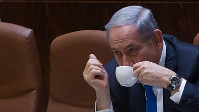 Israeli Prime Minister Benjamin Netanyahu seen drinking coffee during a plenum session in the assembly hall of the Israeli parliament on June 17, 2015. Photo by Miriam Alster/Flash90.