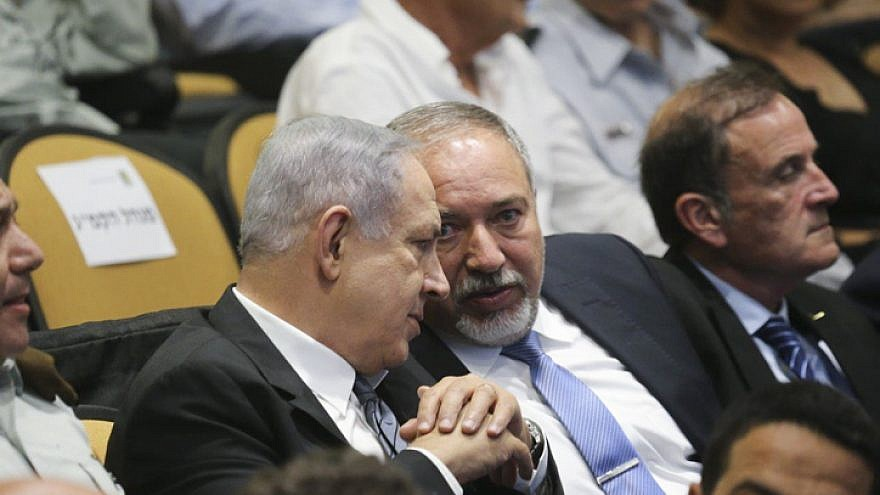 Israeli Prime Minister Benjamin Netanyahu and then-Defense Minister Avigdor Lieberman at a graduation ceremony of the National Security College on July 13, 2016. Photo by Flash90.