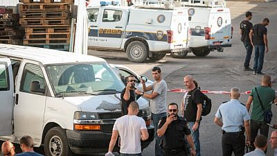 Police at the scene where Reuven Schmerling from the settlement of Elkana was found dead at the industrial zone in Kfar Qasem, Oct. 4, 2017. Photo by Roy Alima/Flash90