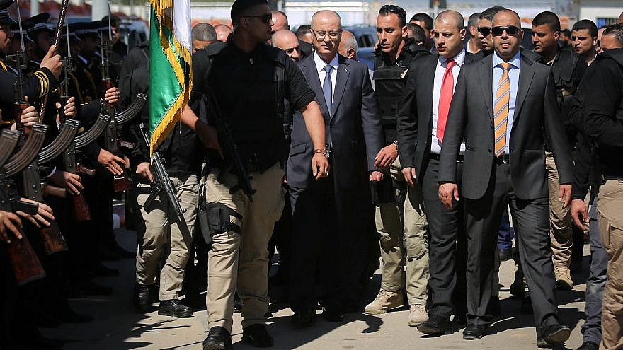 Palestinian Authority Prime Minister Rami Hamdallah, escorted by bodyguards, is greeted by Palestinian policemen upon his arrival in Gaza City on March 13, 2018. Credit: Abed Rahim Khatib/Flash90.