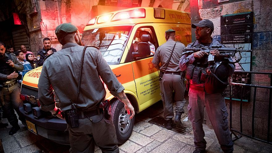 Israeli security personnel at the scene where an Israeli security guard was killed in a terror attack in the Jewish Quarter of Jerusalem's Old City on March 18, 2018. Photo by Yonatan Sindel/Flash90.