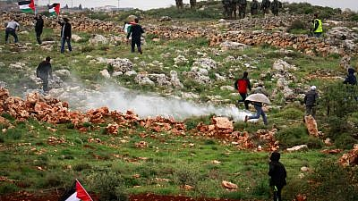 """Palestinian protesters clash with Israeli troops during a protest marking """"Land Day"""" in the West Bank city village of Qusra near Nablus on March 30, 2018. Photo by Nasser Ishtayeh/Flash90."""