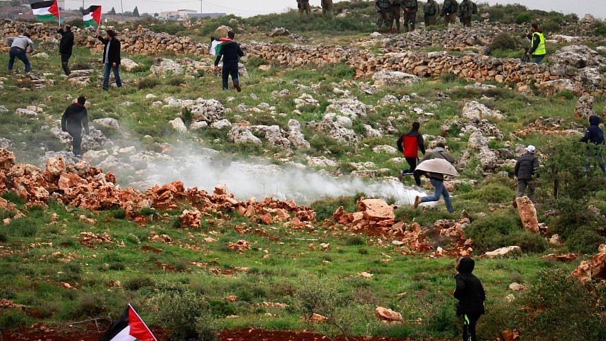 """Palestinian protesters clash with Israeli troops during a protest marking """"Land Day"""" in the West Bank city village of Qusra near Nablus on March 30, 2018. Photo by Nasser Ishtayeh/Flash90"""