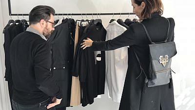 Nir Goeta and Galit Reismann look through Nir's designs. Credit: Eliana Rudee.