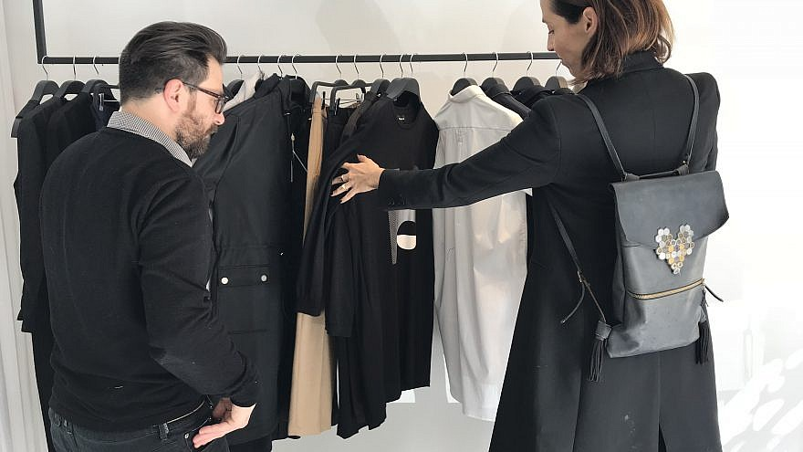 Nir Goeta and Galit Reismann look through Nir's designs. Credit: Eliana Rudee.