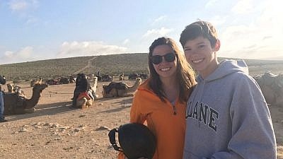 Natalie (right) and Katherine (left) Dubin pose in front of a Birthright staple: camel rides. Credit: Natalie Dubin.