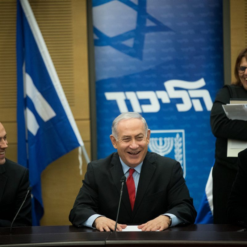 Israeli Prime Minister Benjamin Netanyahu with coalition head and Likud parliament member David Amsalem (right) and Likud parliament member Miki Zohar at a Likud Party faction meeting at the Knesset on Feb. 26, 2018. Credit: Yonatan Sindel/Flash90.