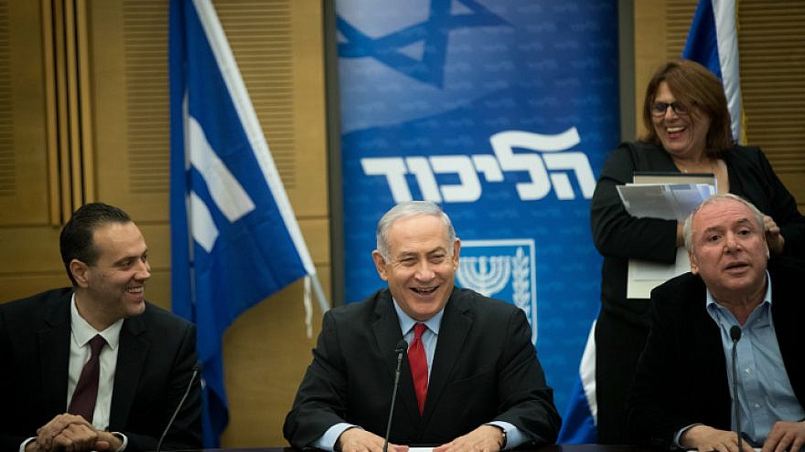 Israeli Prime Minister Benjamin Netanyahu with coalition head and Likud parliament member David Amsalem and Likud parliament member Miki Zohar at a Likud Party faction meeting at the Knesset on Feb. 26 2018. Credit Yonatan Sindel  Flash90