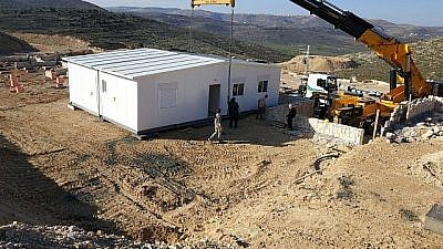 First caravilla is erected on the grounds of the new Amichai settlement for evacuees of Amona on Feb. 21, 2018. Credit: Amona evacuees.