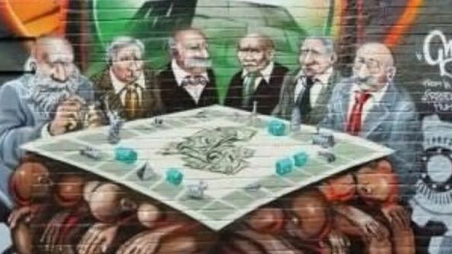 The graphic, Freedom for Humanity, was painted six years ago on a property in London's East End by renowned international graffiti artist Kalen Ockerman. It depicted a group of Jewish businessmen and bankers sitting around a Monopoly-style board, counting money. (Credit: EJP)