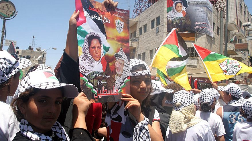 Palestinians hold posters showing Dalal Mughrabi, a terrorist involved in an infamous 1978 attack in which 35 Israelis were killed. Credit: Issam Rimawi/Flash 90.