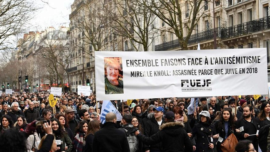 Marchers honor the memory of Holocaust survivor Mireille Knoll, 85, who was murdered last week in a brutal anti-Semitic attack. Credit: European Jewish Press.