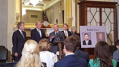 The Taylor Force Act being introduced by Sen. Lindsey Graham (R-S.C.), Sen. Dan Coats (R-Ind.) and Sen. Roy Blunt (R-Mo.) in 2016.  Taylor Force's father, Stuart Force is pictured center-right. Credit: Twitter.