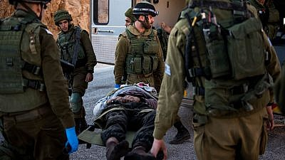 "IDF troops transport an injured Syrian civilian as part of ""Operation Good Neighbor."" Credit: IDF website."