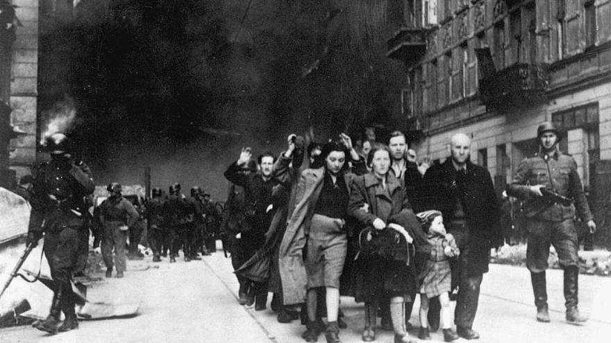 Captured Jews who participated in the Warsaw Ghetto Uprising are rounded up by the Waffen SS on Nowolipie Street, between April 19 and May 16, 1943. Credit: Wikimedia Commons.