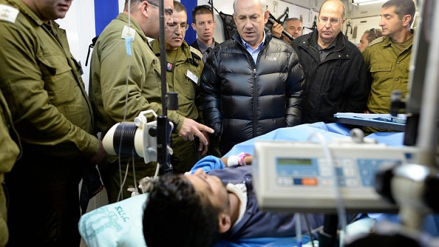 Israeli Prime Minister Benjamin Netanyahu visits at an IDF field hospital, where those wounded in the civil war in Syria were being treated in northern Israel. Feb. 18, 2014. Photo by Kobi Gideon /GPO/FLASH90