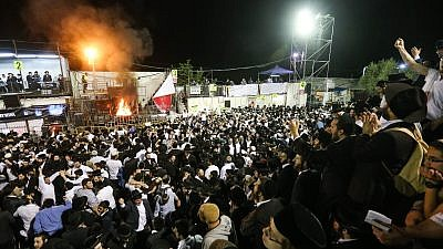 Haredi men take part in the celebration of the Jewish holiday of Lag B'Omer on Mount Meron in northern Israel. May 7, 2015. Credit: Meir Vaknin/Flash90