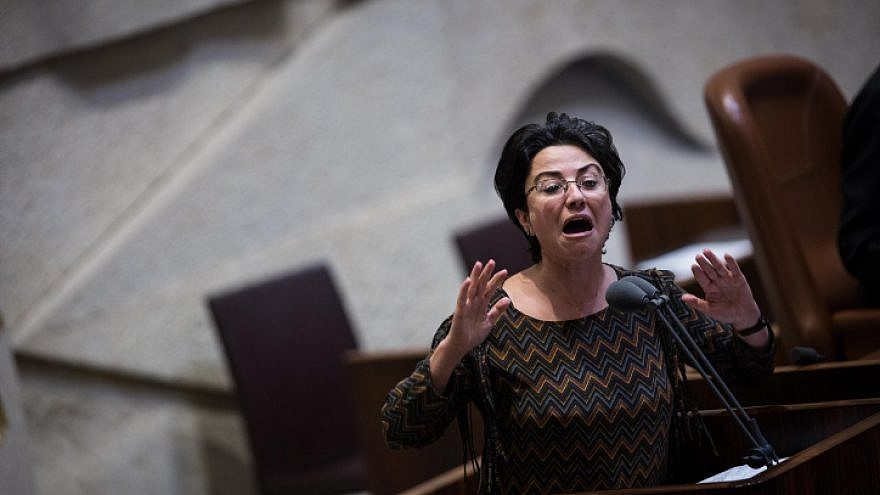 """Knesset member Hanin Zoabi speaks during a vote on the so-called """"Regulation Bill,"""" a controversial bill that seeks to legitimize illegal West Bank outposts, in the Israeli parliament, on Dec. 7, 2016. Photo by Hadas Parush/Flash90."""