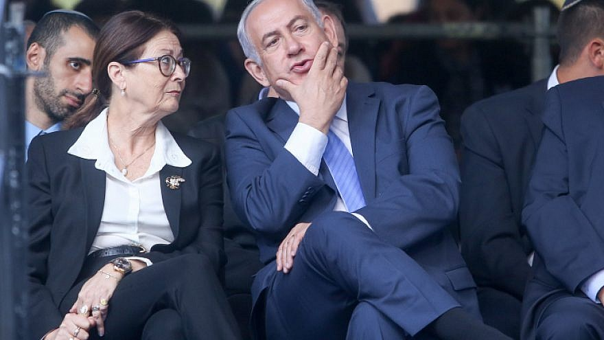 Israeli Prime Minister Benjamin Netanyahu with Supreme Court Chief Judge Esther Hayut during a memorial service marking 22 years since the assassination of Israeli Prime Minister Yitzhak Rabin, held at Mount Herzl cemetery in Jerusalem on Nov. 1, 2017.