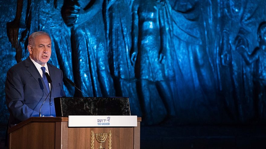 Israeli Prime Minister Benjamin Netanyahu speaks at the official state ceremony held at the Yad Vashem Holocaust Memorial Museum in Jerusalem, as Israel marks annual Holocaust Remembrance Day on April 11, 2018. Photo by Yonatan Sindel/Flash90.