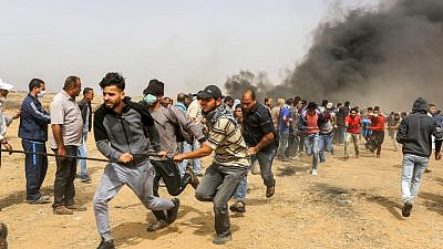 Palestinian protesters during clashes with Israeli security forces on the Gaza Israeli border east of Khan Yunis, in the southern Gaza Strip on April 20, 2018. The riots have continued each Friday since March 30. Credit: Abed Rahim Khatib/Flash90