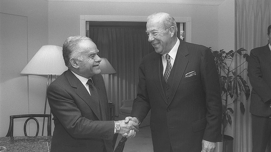 Israeli Prime Minister Yitzhak Shamir greets longtime friend of the Jewish state George Shultz, one of two men to have served in four different U.S. cabinet positions. (Credit: Herman Chanania. GPO)