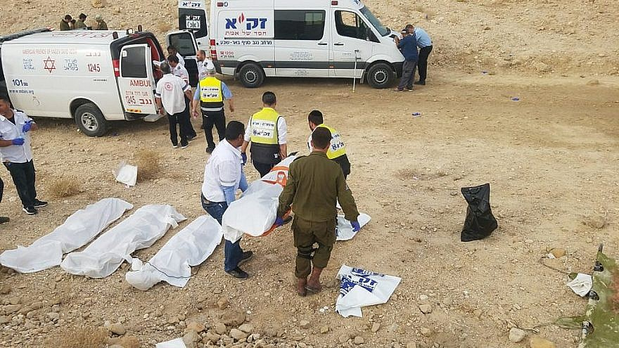 ZAKA emergency volunteers transport the bodies of nine students killed during flash floods while hiking as a group in the Nahal Tzafit riverbed on April 26, 2018. Photo courtesy of ZAKA.