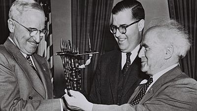 President Harry S. Truman accepts a menorah handed to him by Israeli Prime Minister David Ben-Gurion on a visit to the United States in May 1951. Between them is Israeli Ambassador Abba Eban. Credit: Fritz Cohen, GPO