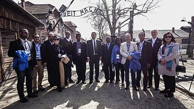 "A delegation of U.N. ambassadors together with Ambassador Danny Danon, Israel's Permanent Representative to the United Nations, at the Auschwitz-Buchenau concentration camp in Poland join the 30th annual ""March of the Living"" pilgrimage on April 12, 2018. Photo courtesy of American Zionist Movement."