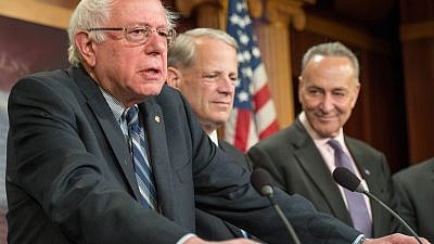 Vermont Sen. Bernie Sanders (left) sits alongside Steve Israel, a former Democrat member of Congress from Long Island, N.Y., and New York Sen. Chuck Schumer (right) on Capitol Hill in 2015. (Wikimedia Commons)